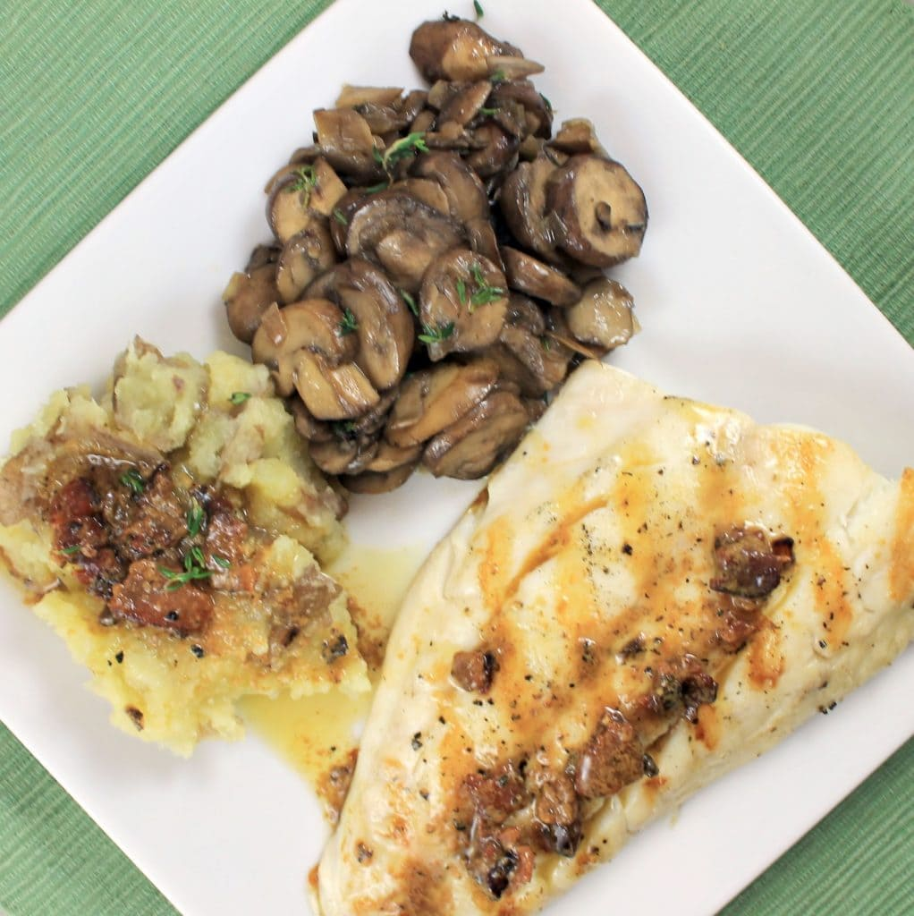 Grilled Striped Bass with Bacon Vinaigrette, Red Smashed Potatoes & Sautéed Butter-Thyme Mushrooms