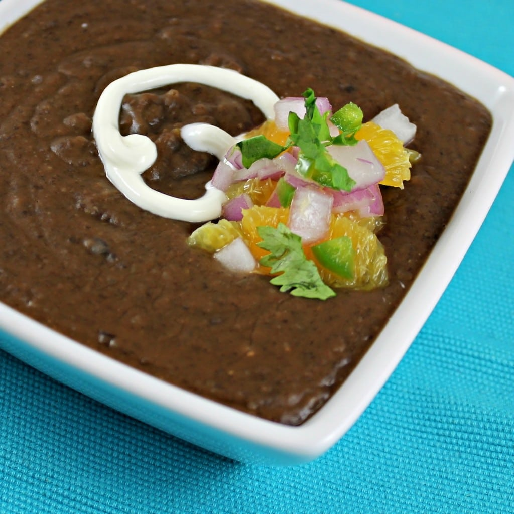 Black Bean Soup with Orange Jalapeno Salsa. Can be eaten warm or chilled. Soup can be made ahead of time. Keep toppings separate until ready to serve. (Vegetarian)