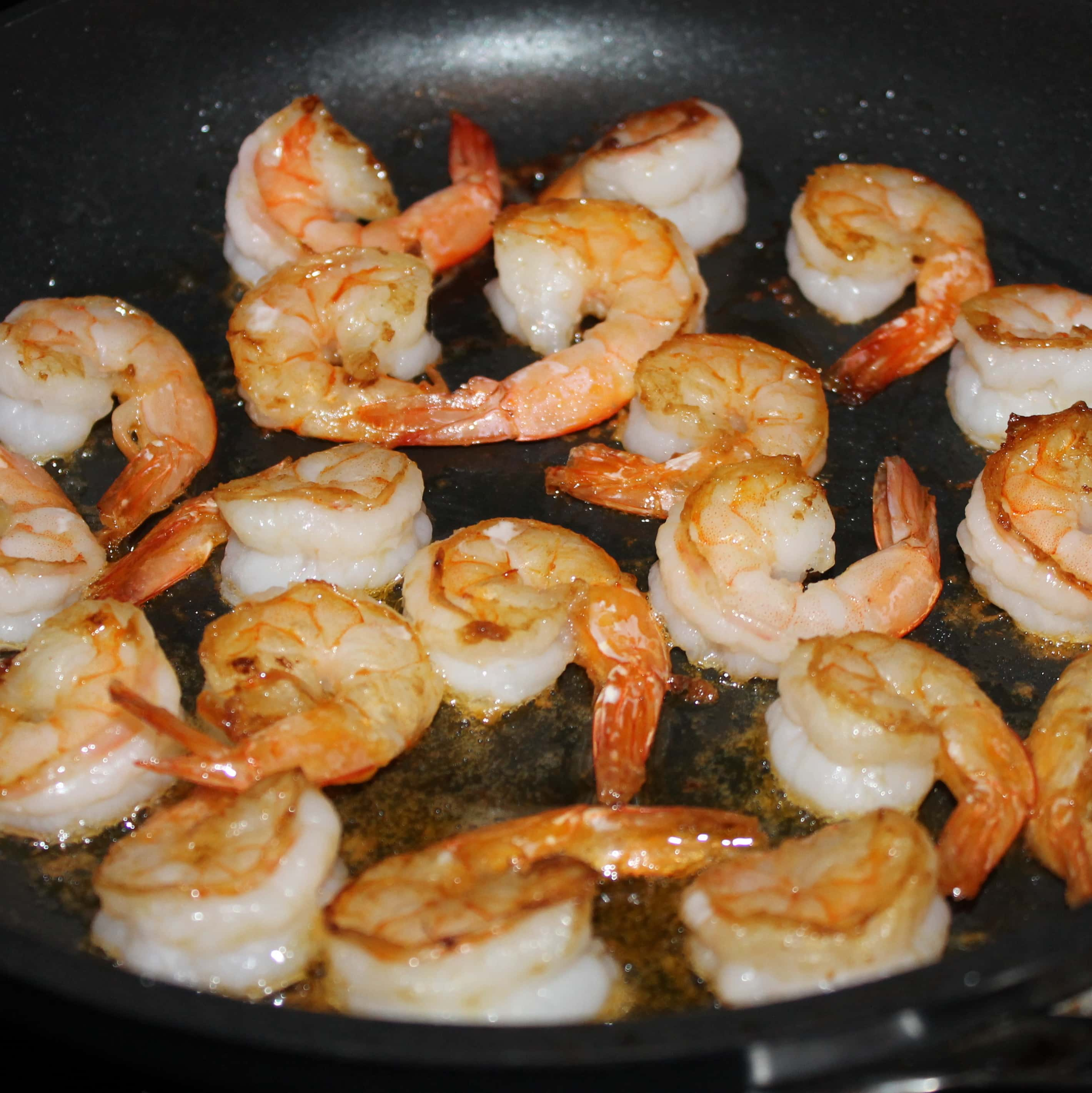 Opaque color shrimp once shrimp are cooked - Cook Until Mostly Evaporated This Takes No Time At All The Hot Pan Will Almost Immediate Evaporate Most Of The Wine